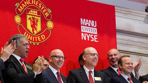 Manchester United executives ring the Opening Bell at the New York Stock Exchange when the soccer club went public Aug. 10, 2012.