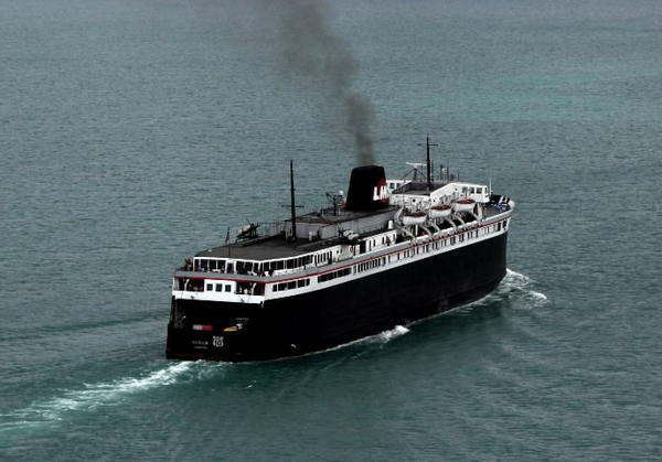 The SS Badger ferry pulls out of the harbor at Manitowoc, Wisconsin on its way to Michigan on Thursday, Sept. 22, 2011.
