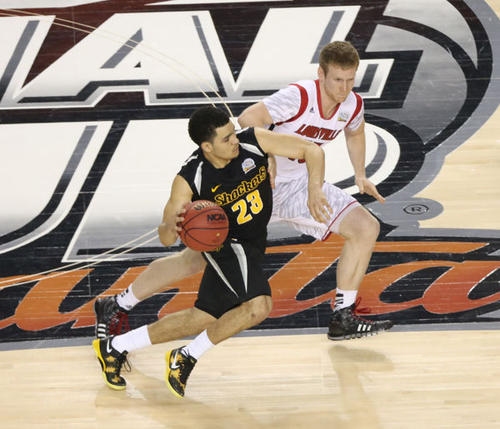 Wichita State Shockers guard Fred VanVleet (23) drives against Louisville Cardinals guard Tim Henderson (15) in the second half of the semifinals during the 2013 NCAA mens Final Four at the Georgia Dome. Mandatory Credit: