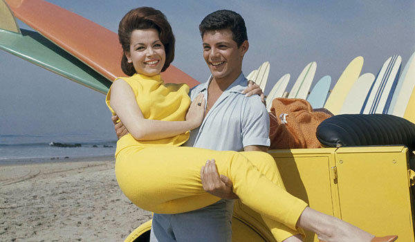 "Annette Funicello and Frankie Avalon during filming of 1963's ""Beach Party."""