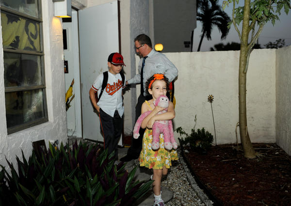 Toby Srebnik gets up early to leave his Coral Springs home with his son Bailey, age 9, and daughter Riley, age 5.