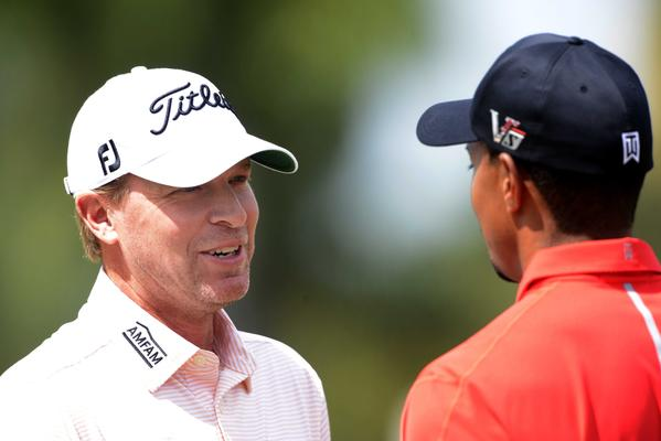 Tiger Woods (right) talks with Steve Stricker on the practice green before the final round of the WGC Cadillac Championship at Trump Doral Golf Club in March.