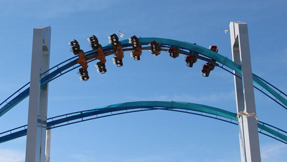 Gatekeeper flies through the twin keyhole element atop the entrance to Cedar Point during a test run of the winged coaster.