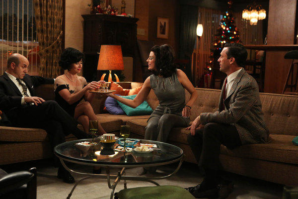 "Arnold Rosen (Brian Markinson), Sylvia Rosen (Linda Cardellini), Megan Draper (Jessica Pare) and Don Draper (Jon Hamm) ring in a new year on ""Mad Men."""