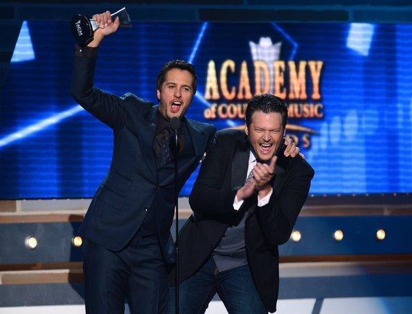 Co-hosts and recording artists Luke Bryan, left, and Blake Shelton speak onstage after Bryan accepted the Entertainer of the Year award during the 48th Annual Academy of Country Music Awards at the MGM Grand Garden Arena on Sunday in Las Vegas.