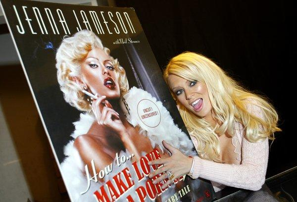 "Former porn star Jenna Jameson poses with a poster during a promotion for her book ""Make Love Like A Porn Star."""