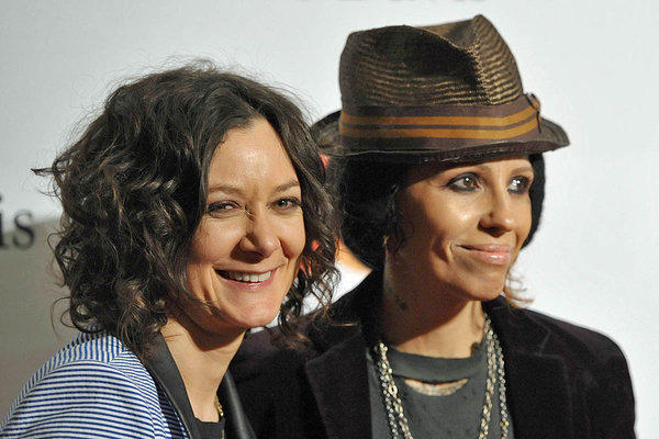 "Sara Gilbert, with girlfriend Linda Perry at Clive Davis' pre-Grammy party in February, announced their engagement Monday on ""The Talk."""