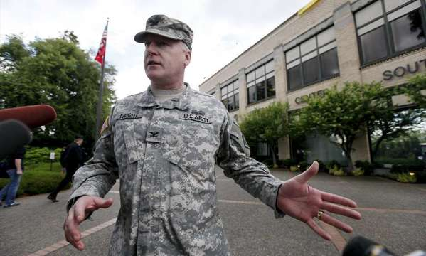 Col. Anthony Wright speaks with media outside the Seattle Military Entrance Processing Center in this file photo. Two men have been sentenced in a plot to attack the center.