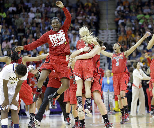 Louisville players celebrate after knocking off California to advance to the NCAA championship game.