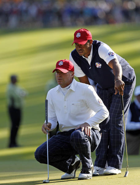 Steve Stricker and Tiger Woods during the Ryder Cup at Medinah in September. (Brian Cassella/Tribune Photo)