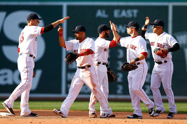 BOSTON, MA - APRIL 8: Members of the Red Sox including Shane Victorino #18, Daniel Nava #29, and Jacoby Ellsbury #2 celebrate following their 3-1 win against the Baltimore Orioles during the Opening Day game on April 8, 2013 at Fenway Park.