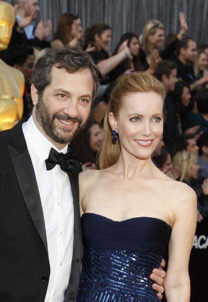 Judd Apatow and Leslie Mann attend the 84th Annual Academy Awards in 2012.