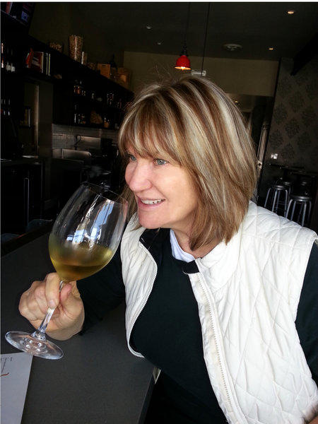 Josie LeBalch, chef/owner of Josie and Next Door in Santa Monica, with a glass of her current favorite, a Pecorino from the Marche region of Italy.