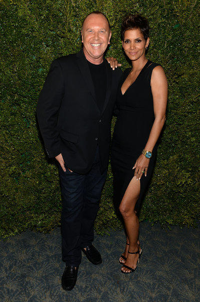 Michael Kors and Halle Berry attend a dinner in honor of Berry joining Kors and the United Nations World Food Program to help fight hunger around the world.