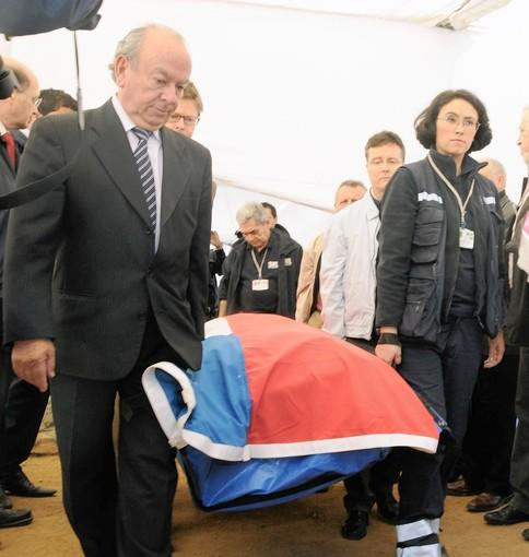 Coroner's personnel and relatives of Chilean poet Pablo Neruda accompany his remains in Isla Negra after the exhumation, in a photo provided by Chile's judiciary.