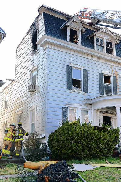 Firefighters put out hot spots at 46 E. North Ave. in Hagerstown after a fire there sent two people to hospitals Monday morning.