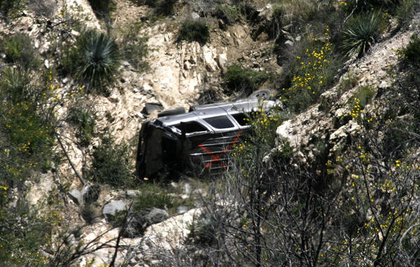 A vehicle rests on its side, found over the edge of the Angeles Crest Highway at mile marker 31.82 on Monday, April 8, 2013. No victims were found at the scene.