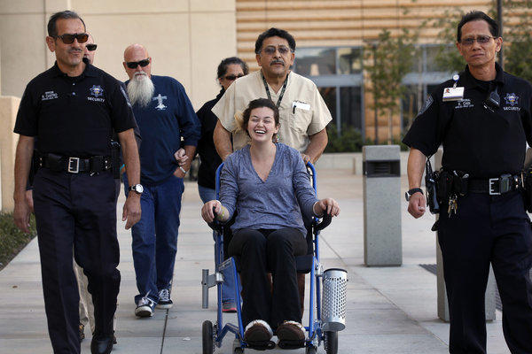 Rescued hiker Kyndall Jack, 18, is wheeled to address the media during a press conference in front of UC Irvine Medical Center.