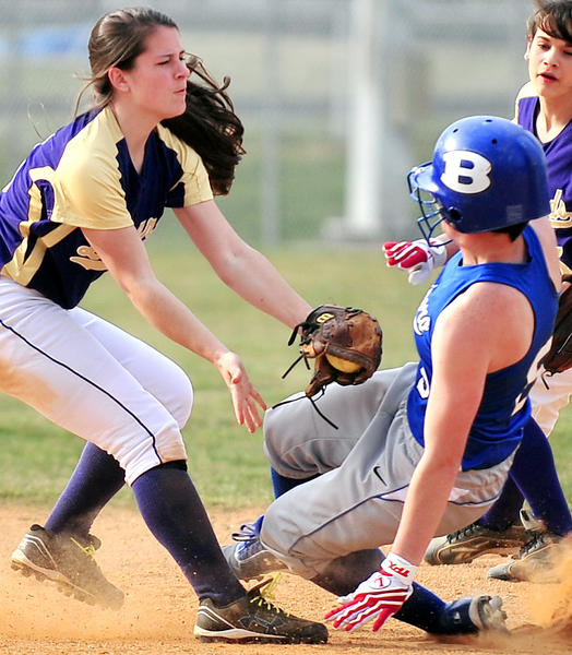 Smithsburg's Kayla Huntzberry, left, tags out Boonsboro's Leah Cadigan at second base during Monday's MVAL Antietam softball game.