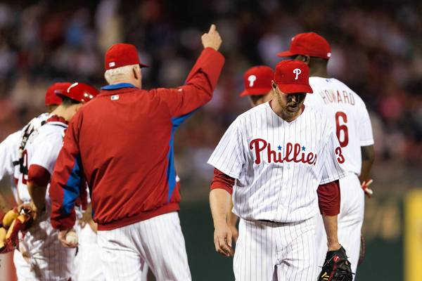 Phillies manager Charlie Manuel calls for a relief pitcher as Roy Halladay walks off the mound during the fifth inning.