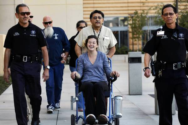 Rescued hiker Kyndall Jack, 18, is wheeled out to address the media in front of UC Irvine Medical Center in Orange. Her hiking companion, Nicolas Cendoya, 19, was found the day before she was.