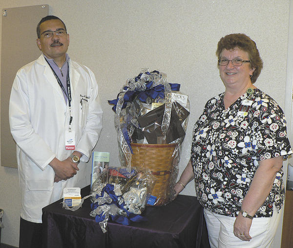 Dr. Juan Tayler, left, is shown with Debby Cushwa, who won the basket raffle sponsored in March by the Endoscopy Center at Robinwood.