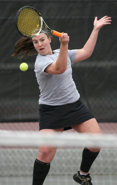 Northern States Jamie Golden returns a volley during a match two years ago at the NSU tennis courts. American News File Photo by John Davis