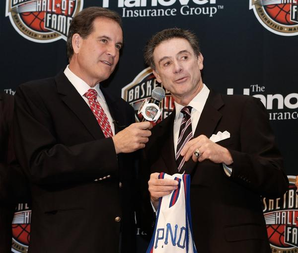 CBS broadcaster Jim Nance talks to Louisville Coach Rick Pitino during the Naismith Memorial Basketball Hall of Fame announcement ceremony.