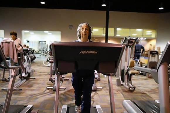 Carol Johnson, 80, works out on a treadmill at a recreation center in Sun City