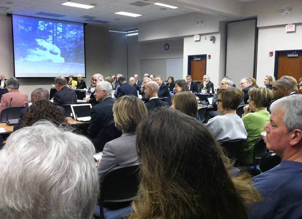 Former Penn State footbal players ask university trustees March 15 in Dauphin County to take steps to clear Joe Paterno's name in the Jerry Sandusky child-sex abuse scandal.
