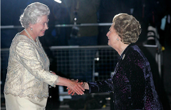 Former British Prime Minister Margaret Thatcher, right, greets Queen Elizabeth II as she arrives for Thatcher's 80th birthday party at the Mandarin Oriental Hotel in London.