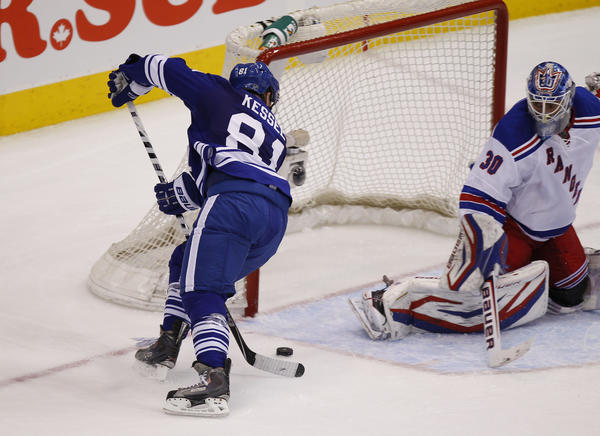 Toronto Maple Leafs right wing Phil Kessel (81) scores the game winning goal on New York Rangers goaltender Henrik Lundqvist (30) during the third period at the Air Canada Centre. Toronto defeated New York 4-3.