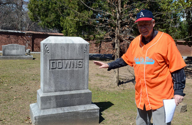"Alan Morris shows graves of some of Atlanta, Georgia's earliest baseball players at Oakland Cemetery, on March 21, 2013. Samuel Downs, was described as Atlanta's ""most honest man,"" so he was a natural to be the umpire in the game."