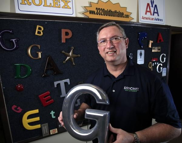 Small-business owner Bob McEwen started Sign Craft Solution in Wake Forest, N.C., a little over three years ago after he was laid off.