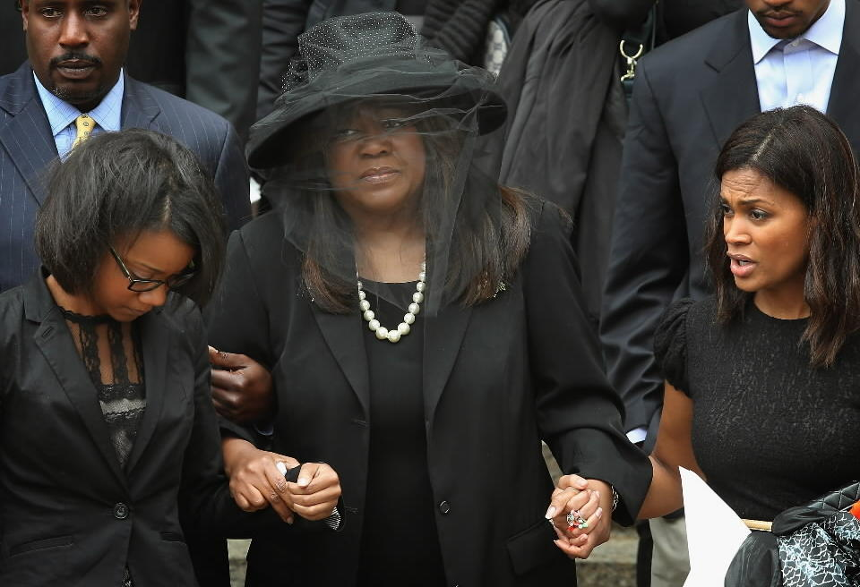 Chaz Ebert, the wife of film critic Roger Ebert, leaves Holy Name Cathedral following a funeral service for her husband on Monday.