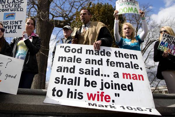 Protesters demonstrate outside the Supreme Court on March 27 after the justices heard oral arguments in the Defense of Marriage case.