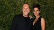 "Halle Berry and Michael Kors have teamed up to work with the United Nations World Food Program. They designed two watches that will be sold to benefit the organization. For every watch sold, 100 meals for hungry children will be provided. The watches will be sold in Michael Kors stores and at MichaelKors.com. <a href=""http://www.latimes.com/entertainment/gossip/la-et-mg-halle-berry-pregnant-michael-kors-watch-hunger-stop-20130408,0,7176566.story"">[Los Angeles Times]</a>"
