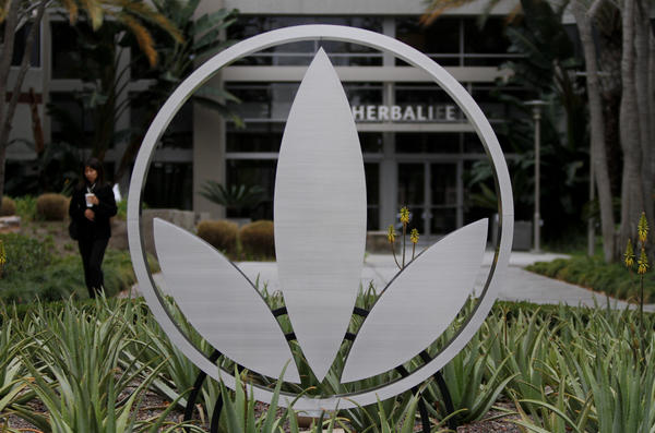 The Herbalife logo is mounted in a garden of aloe plants at company headquarters in Torrance.