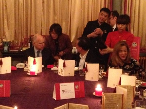 Gov. Jerry Brown dines with delegates at the China Club in Beijing.