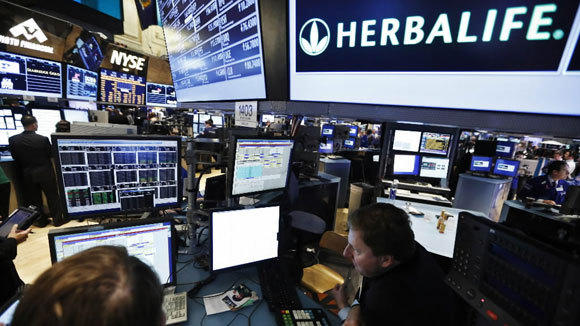 Traders work at the Herbalife post at the New York Stock Exchange in a Jan. 10 photo.