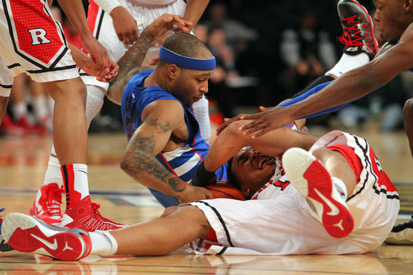 DePaul's Montray Clemons and Rutgers' Derrick Randall battle for a loose ball during the Big East tournament in March.
