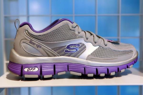 Skechers said Tuesday that KPMG had resigned as its auditor amid an insider trading investigation.