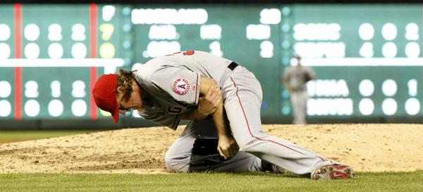 Jered Weaver grimaces in pain after injuring his elbow against the Texas Rangers on Sunday.