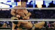When John Cena beat The Rock in Wrestlemania 29 on Sunday night, it was big news for WWE fans. But just where should those fans go when trying to read about that news -- the sports pages or the entertainment section?