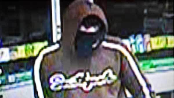 A surveillance photo of a man wanted in connection with the armed robbery of a 7-Eleven store in Glendale Heights.