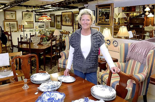 Cheryl Phelps is the co-owner of A Touch of Class Furniture & Glassware Emporium at 308 W. Congress St. in Charles Town, W.Va.