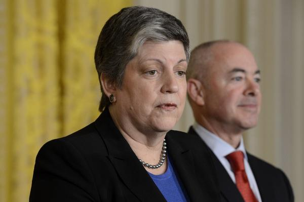 Homeland Security Secretary Janet Napolitano with Alejandro Mayorkas, director of U.S. Citizenship and Immigration Services, at a naturalization ceremony last month.