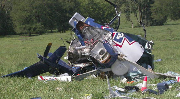 This photo shows the wreckage of a helicopter that crashed near Mosby, Mo. The pilot of an emergency medical helicopter may have been distracted by text messages.