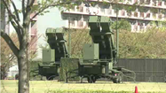 Japan readied its missile defense systems Tuesday against a possible North Korean weapons test, saying it would shoot down any missiles or debris if Japanese territory was threatened.