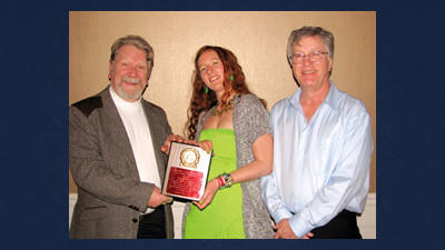 From left, are Larry Hutchinson, founder and Brynn Waylonis, president of the Shade Creek Watershed Association receive the President's Award from Randy Buchanan, president of the Mountain Laurel Chapter of Trout Unlimited.